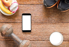 Iron dumbbell,Sports shoes and smart phone with milk and Iron du Royalty Free Stock Images