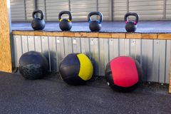 Iron dumbbells of different weights with multi-colored handles s royalty free stock photography