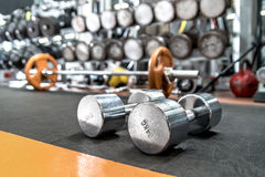 Iron dumbbells in gym , interior indoor Stock Photos