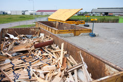 Free Iron Dumpster With Groundwood  At A Refuse Dump Stock Photography - 20430812