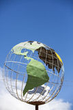 Iron earth globe structure with blue sky and South American cont Royalty Free Stock Photography