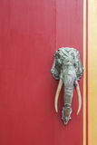 Iron elephant. Decorated on red door royalty free stock photography