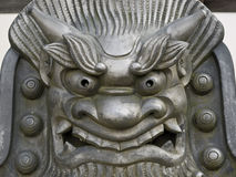 Iron face statue. Close-up of cast iron metal face statue outside Tenryu-ji temple in Arashiyama in Kyoto royalty free stock images