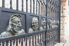Iron faces in the Colonial City royalty free stock image