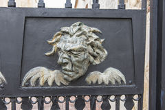 Iron faces in the Colonial City Stock Photo