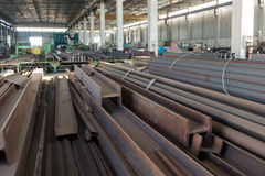 The iron factory. The numerous iron bars inside a factory royalty free stock photo
