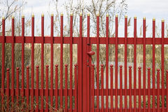 Iron fence. A red iron fence as a demarcation of a lake stock photography