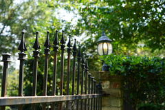 Free Iron Fence  And Lamp Surrounds Estate Stock Photos - 60075713