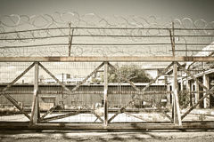 Iron fence & barbed wire. View of a iron fence with a barbed wire Stock Images
