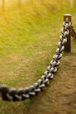 Iron fence. With black chain in a city Royalty Free Stock Photo