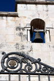 Iron fence and church bell on the white marble wall on Saint Philip and James Cathedral in Sorrento, Italy Stock Photo