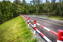 Iron fence Desert road Stock Images