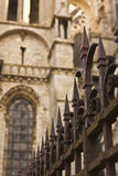 Iron Fence and Gothic Cathedral Stock Photos