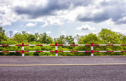 iron fence and road Stock Image