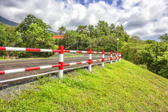 Iron fence and road Royalty Free Stock Images