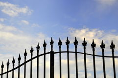 Iron fence with the sky as background Stock Photos