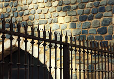 Iron fence with wall background. Spain Stock Images