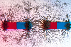 Iron filings on the magnetic field on a magnet Stock Photography