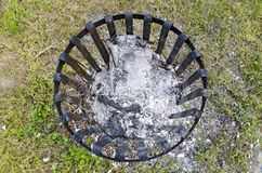 Iron firebasket with ash of burned paper Royalty Free Stock Photo