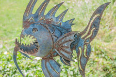 Art Fish. Metal fish in front of grass Stock Photography
