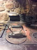 Iron2. Flat iron, cast iron warming up on an antique wood stove Stock Image
