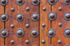 Iron flower pattern over wooden door Stock Photography