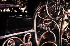 Iron flowers chair. Some chairs an tables wrought iron made Stock Images
