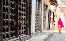 Iron forged gate door on african street Stock Images