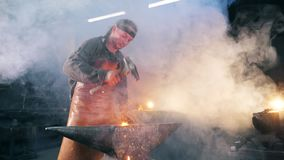 Iron forging process held by the blacksmith. Slow motion. Iron forging process held by the blacksmith. HD stock footage