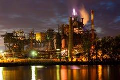 Iron foundry at night. Iron foundry at summer night royalty free stock image