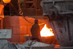 Iron foundry. Smelting metal. Smelting metal liquid iron foundry royalty free stock images