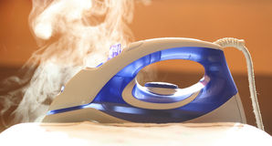 Iron with fume Stock Images