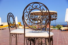 Iron furniture. Two iron chairs and iron table royalty free stock photos