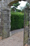 Iron garden gates. Large ornate iron garden gates Stock Image