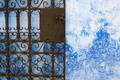 Iron gate. Moroccan iron gate, and blue wall Royalty Free Stock Photos