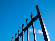 Iron gate. On bright blue sky Royalty Free Stock Image