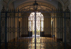 Iron gate. Ancient wrought-iron gate in a building hall in Bologna, Italy Stock Image