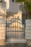 Iron gate. Beautiful iron gate and view to the private yard Royalty Free Stock Photos