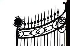Iron gate. Close-up of a castle iron gates against a white background stock photos