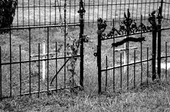 Iron Gate. Small iron gate surrounds a tiny grave site Royalty Free Stock Images