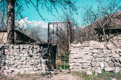 Iron gate on the background of blue sky and trees royalty free stock photos