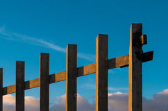 Iron gate on blue sky Stock Photos