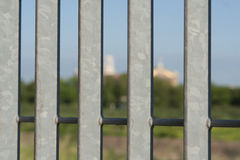 Iron gate with blurred church in rome. An iron gate with the church of st paul on the background Stock Photography
