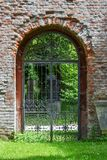 Iron gate in brick wall stock photo