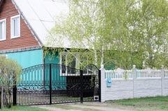 Iron gate and concrete fence Stock Photos