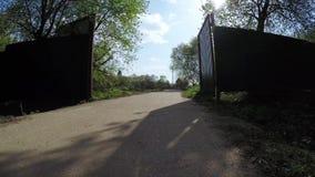 Iron gate and concrete path stock video