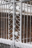 Iron gate covered by snow Royalty Free Stock Photography