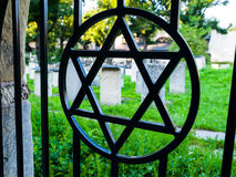 Iron gate with David star at jewish cemetery Stock Images