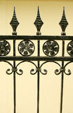 Iron gate details. Forged Metal fence - a portion of a beautiful ornate wrought iron fence in details.  Floral and with arrow head motifs, simple and elegant Stock Photos