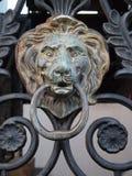 Iron Gate Door Knocker. Image of an iron lion head door knocker Stock Image
